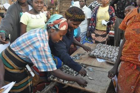Market women arrange their goods in a neighbourhood in Bukavu, Democratic Republic of Congo.